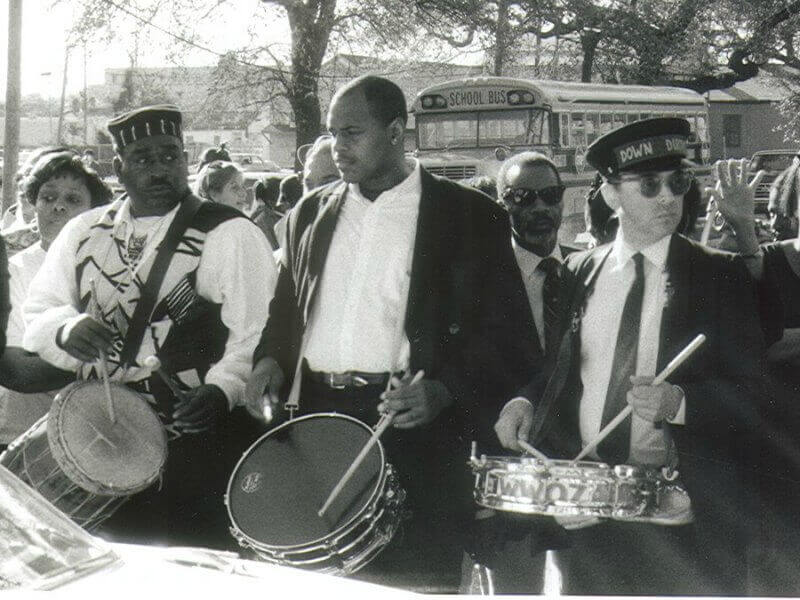 Musicians playing the drums at a jazz funeral