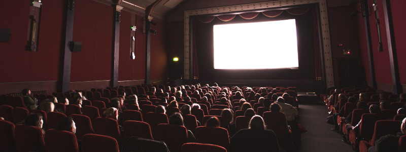 People watching a film in a movie theatre