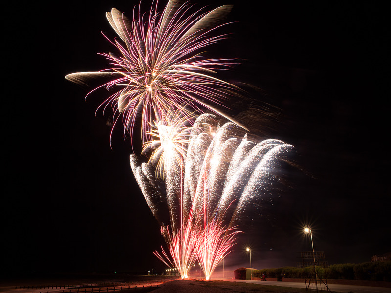Pink and white fireworks create showers of stars