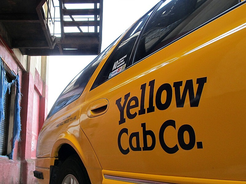 This looks like a photograph of an iconic American Yellow Cab, but in fact it is a hearse
