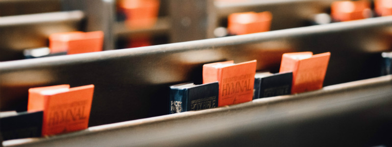 Hymnal books on church pews