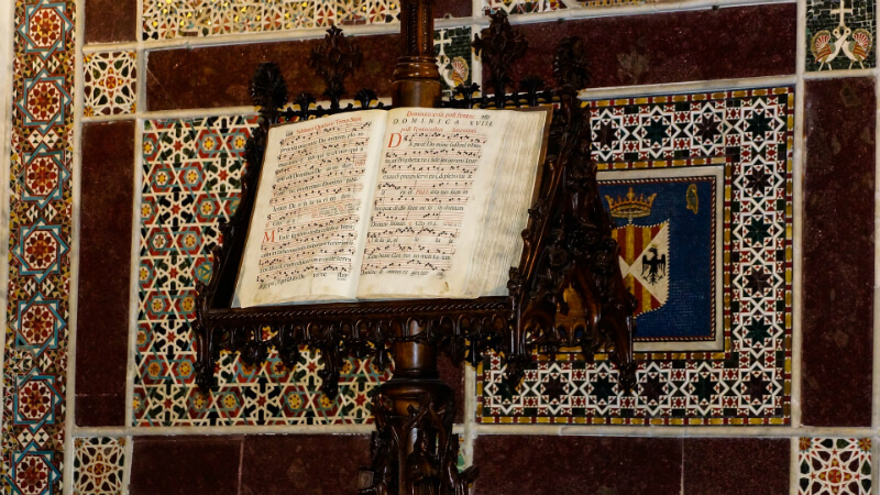 An old book of hymns on a lectern