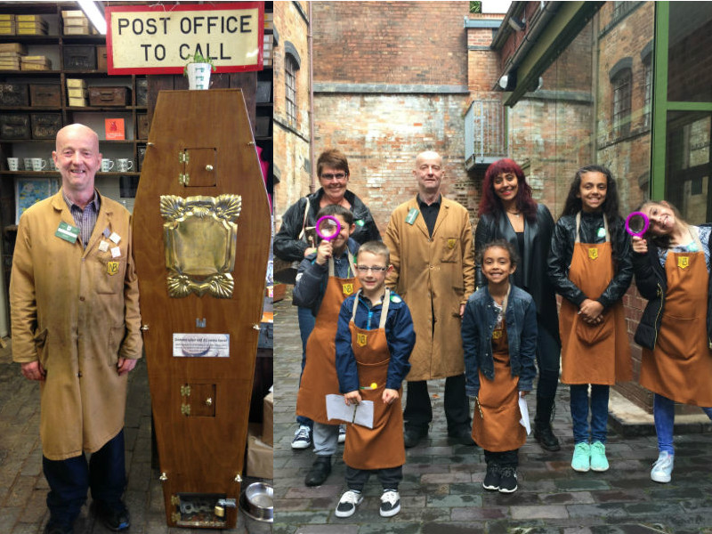 funeral museums: young visitors and tour guide Conelius at the  Newman Brothers Coffin Worls museum, Birmingham