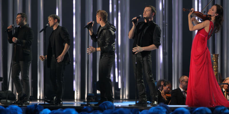 Westlife singing, accompanied by violinist