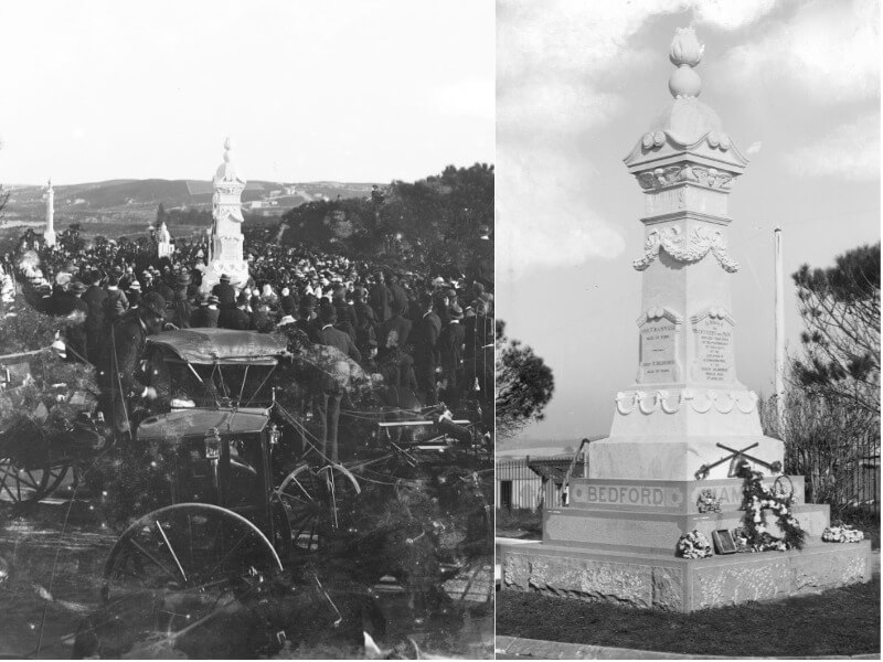 A crowd of people gathered around a white marble monument, and a close up of the monument with a funeral wreath laid at its base