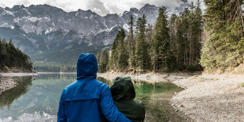 Couple standing together at the edge of a lake