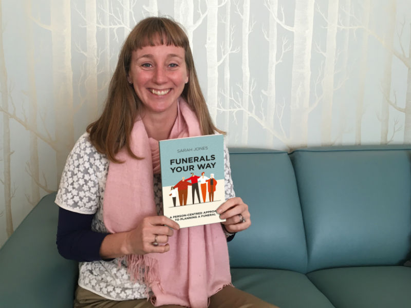 funeral director sarah Jones with her book, Funerals Your Yay