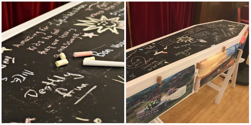 A coffin with blackboard lid where people can write in chalk