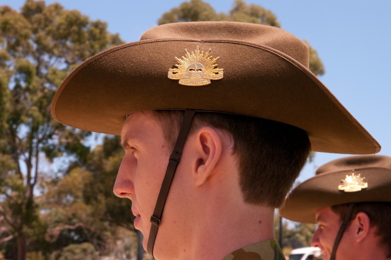 Close up of Australian soldier wearing a slouch hat with the rising sun badge on the side