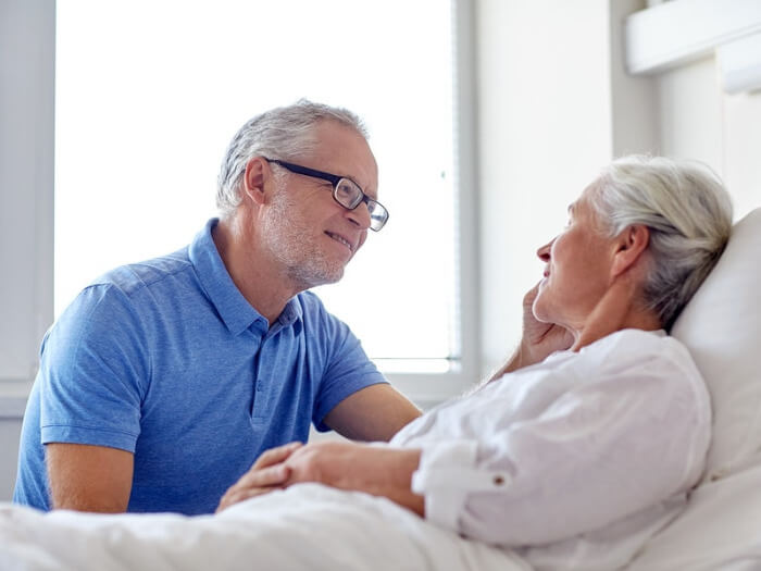 Man talking to wife about her end of life wishes