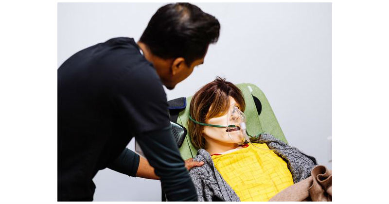 A student nurse works with hi-tech mannequin Julia, to learn how to reassure real-life patients who are dying