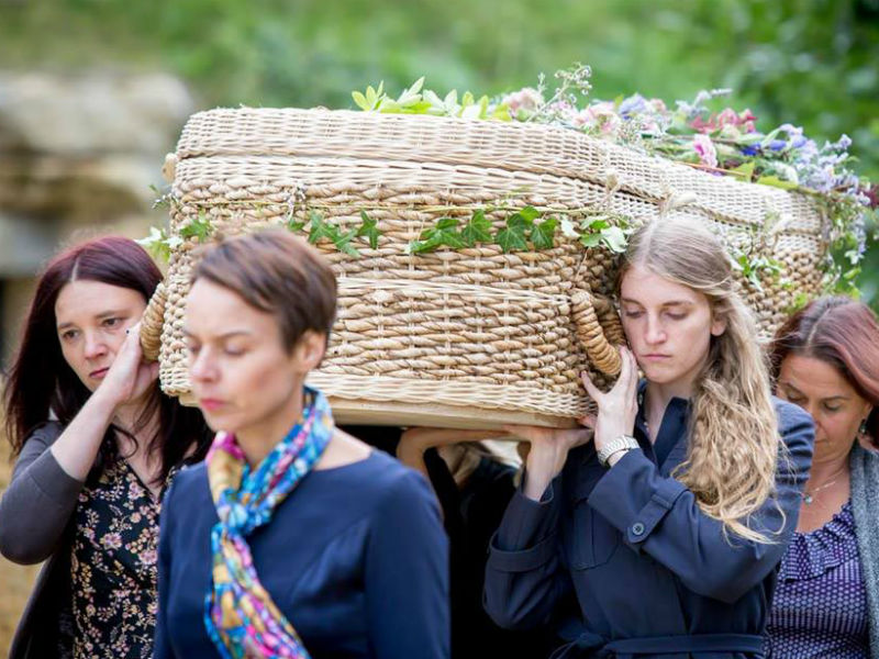 Mourners bearing a wicker coffin