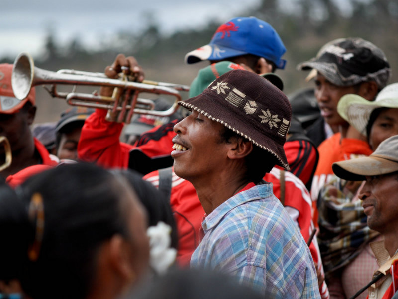 A man plays the trumpet during the Famadihana celebrations