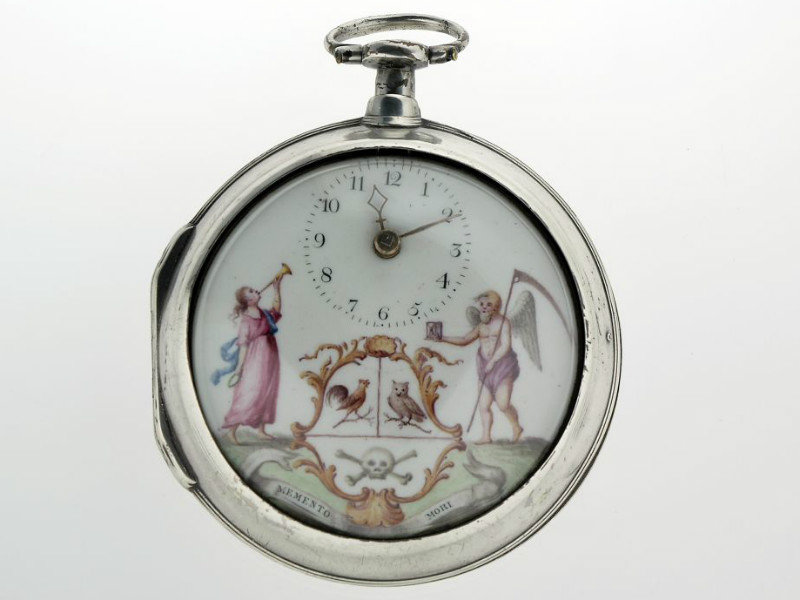 A silver watch with a painted face