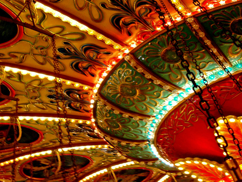 detail of a colourful vintahe merry-go-round