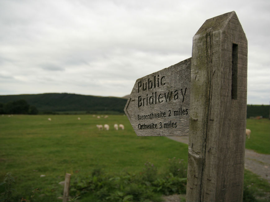 A fingerpost pointing the way in a rural Lake District location