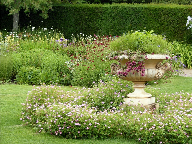 A traditional style garden urn full of flowering plants