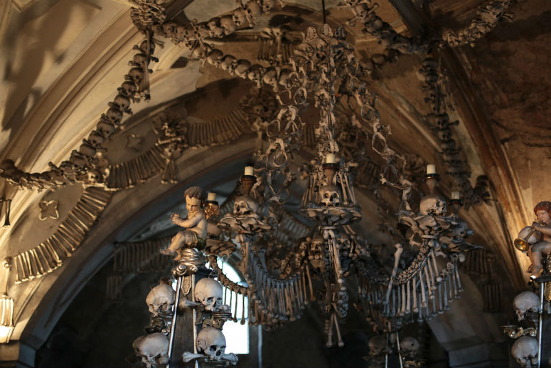 Interior of Sedlec Church, decorated with human bones, including a chandelier with several skulls