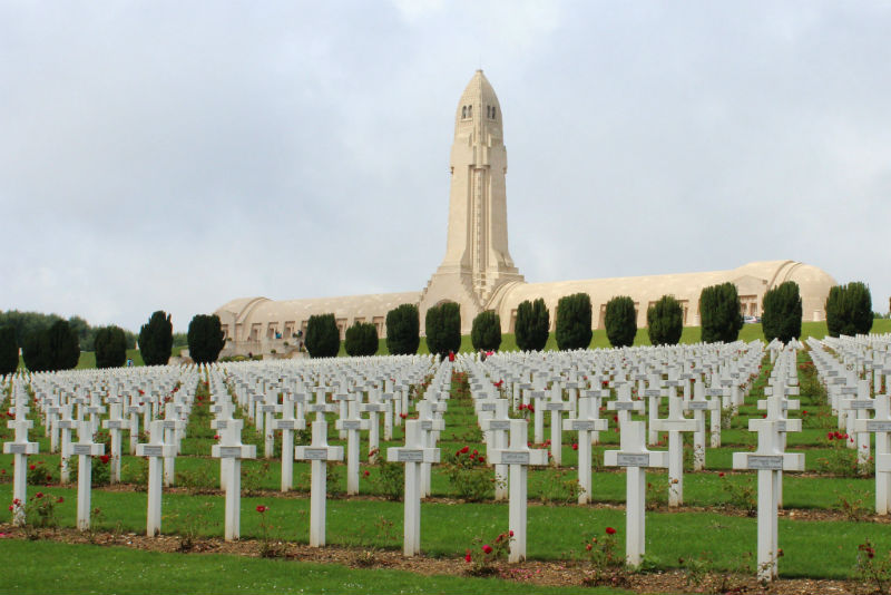 View of Douaumont Ossuary from the cemetery, with crosses and poppies in the front)
