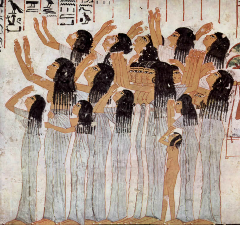 An image featuring Egyptian mourners with hieroglyphics above them