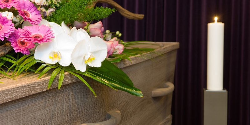 A coffin with funeral flowers