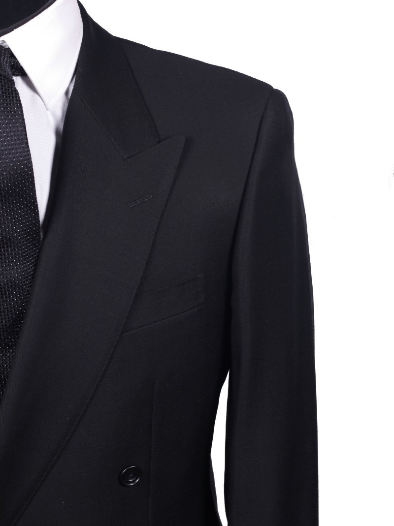 Close up of left brest of a black suit with a white shirt & black tie