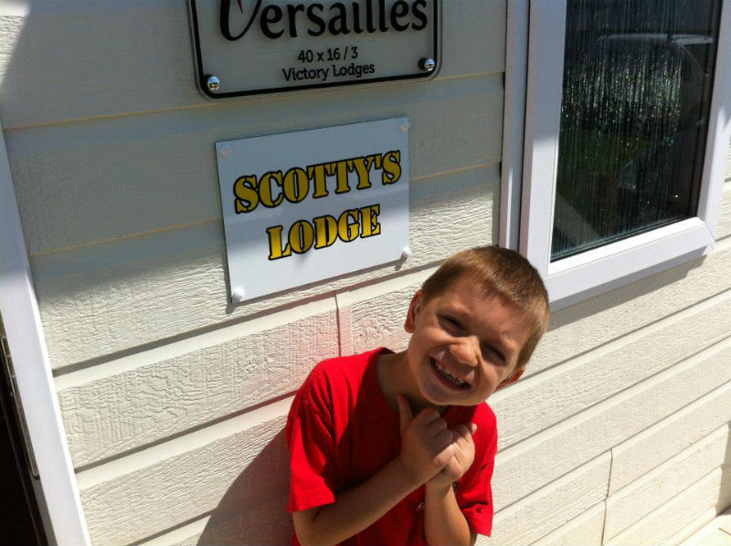 Kai Scott gives the thumbs up at one of charity Scotty's Little Soldiers' holiday lodges for bereaved families