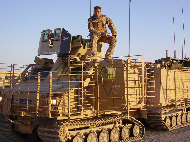 Corporal Lee Scott pictured at ease on an armoured vehicle, while on tour of duty