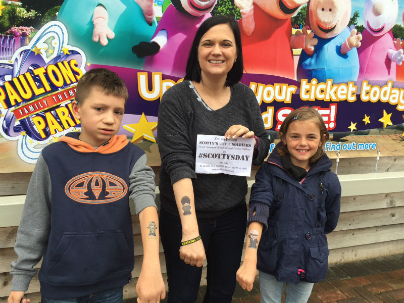 Kai, Nikki and Brooke Scott don temporary tattoos to mark Scotty's Little Soldiers' annual remembrance day