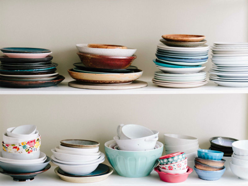 shelves of mismatched crockery