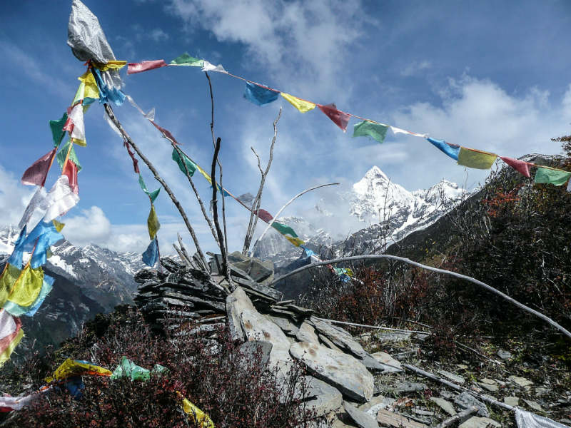Multi-coloured Tibetan flags on a mountain-top