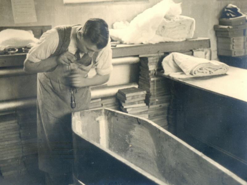 Undertaker at work building coffin