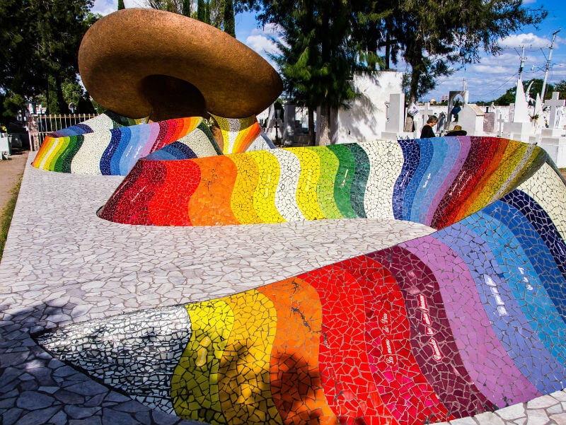 The Jiménez mausoleum, a huge sombrero and rainbow-striped shawl made from mosaic