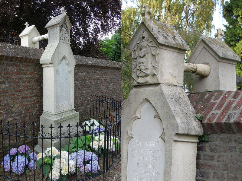 Two graves on opposite sides of a wall, with stone hands emerging from the top of the headstone, holding hands across the top of the wall