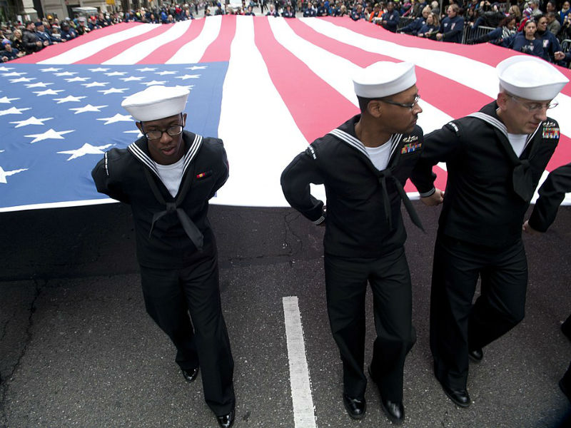Sailors take part in a Veterans Day parade