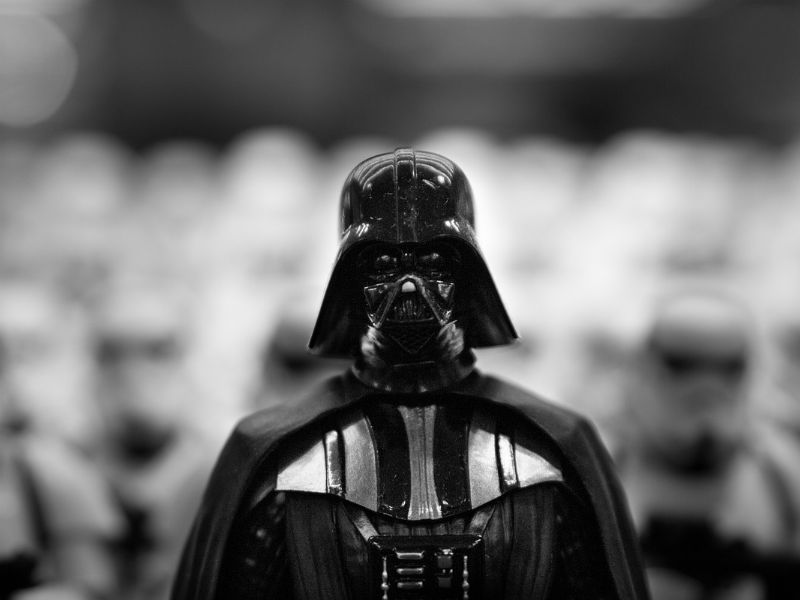 A person dressed in Darth Vader costume
