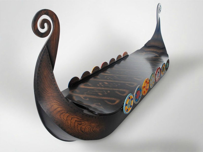 A bespoke coffin shaped like a Viking ship