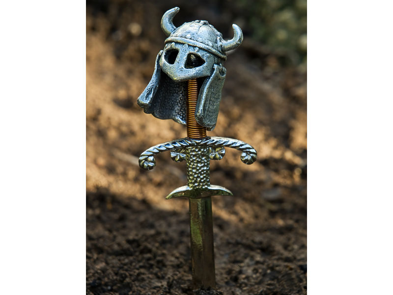 A Viking sword and helmet on a grave