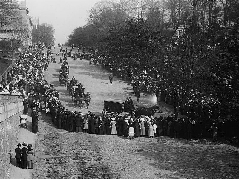 Crowds lining the streets to watch a funeral procession