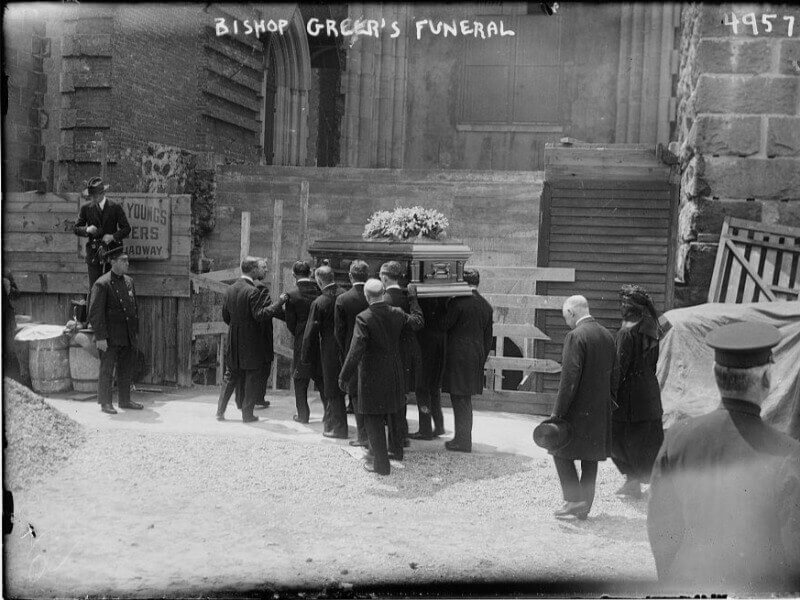 Pallbearers carry the casket to the Cathedral