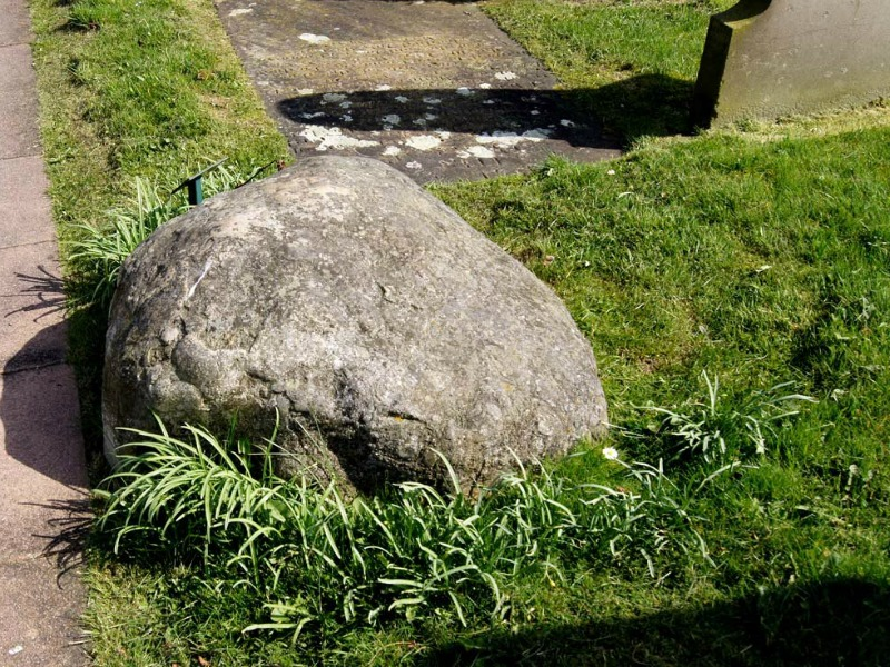 Meg Shelton's grave is covered by a large boulder